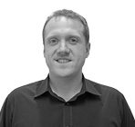 A black and white photo of John Carpenter, Head of Customer Services executive at Rapid Formations.